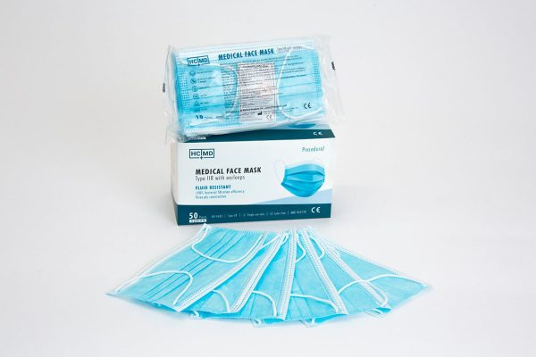 Box of type IIR medical face masks in packs of 10 laid out