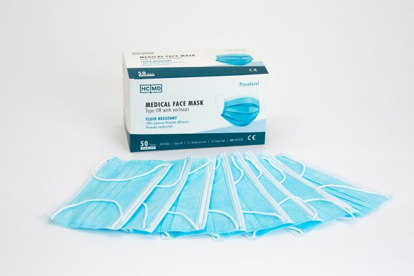 Type IIR medical face masks in packs of 10 laid out