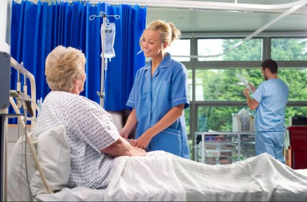 Nurse taking care of patient with Disposable Curtains in the background